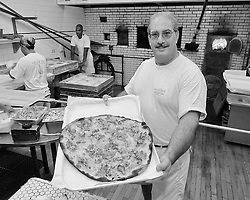 Frank Pepe Pizzeria Kitchen Crew, Oven and Pie with co-owner Gary Bimonte