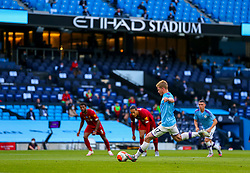 MANCHESTER, ENGLAND - Thursday, July 2, 2020: Manchester City's Kevin De Bruyne scores the first goal from a penalty-kick during the FA Premier League match between Manchester City FC and Liverpool FC at the City of Manchester Stadium. The game was played behind closed doors due to the UK government's social distancing laws during the Coronavirus COVID-19 Pandemic. This was Liverpool's first game as Premier League 2019/20 Champions. (Pic by Propaganda)