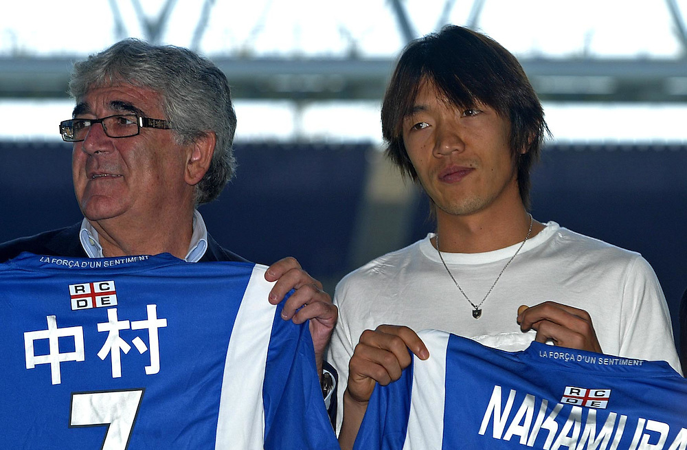 "July 13th. 2009. Official presentation of Shunsuke Nakamura as a  new player of the R.C.D. Espanyol of Barcelona. More than seven thousand supporters and numerous mass media have been present  in the presentation of the new player of the team of first Spanish division league  ""La Liga"".July 13th. 2009. Official presentation of Shunsuke Nakamura as a  new player of the R.C.D. Espanyol of Barcelona. More than seven thousand supporters and numerous mass media have been present  in the presentation of the new player of the team of first Spanish division league  ""La Liga"". In the image  the Japanesse player with the president of R.C. D. Espanyol, Mr. Daniel Sanchez Llibre, on his right side."