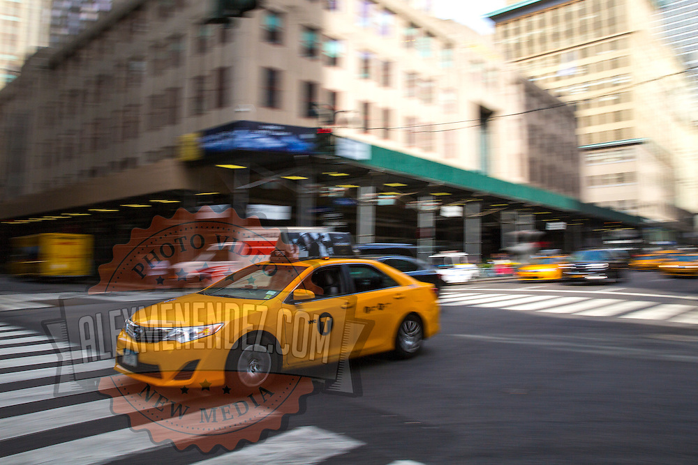 A taxi cab is seen racing down a street in New York City on Monday, September 28, 2015.  (Alex Menendez via AP)