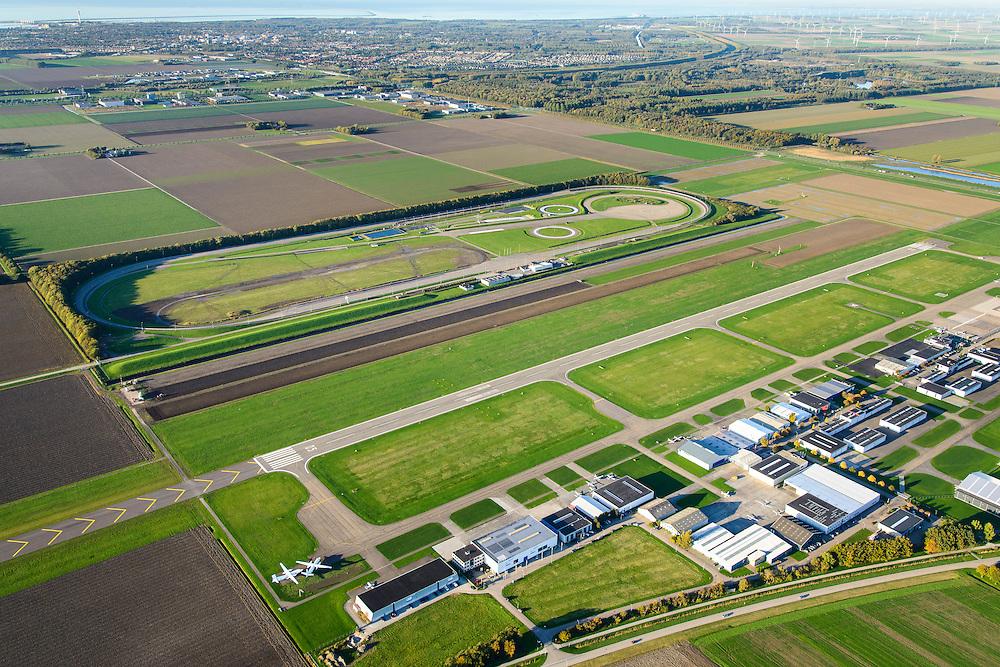 Nederland, Flevoland, Lelystad, 24-10-2013. Vliegveld Lelystad Airport met naast de start- en landingsbaan de testbaan van de Rijksdienst voor het Wegverkeer (RDW). Markermeer in de achtergrond.<br /> Lelystad Airport in the polder in between the farmland of the province Flevoland.luchtfoto (toeslag op standaard tarieven);<br /> aerial photo (additional fee required);<br /> copyright foto/photo Siebe Swart.
