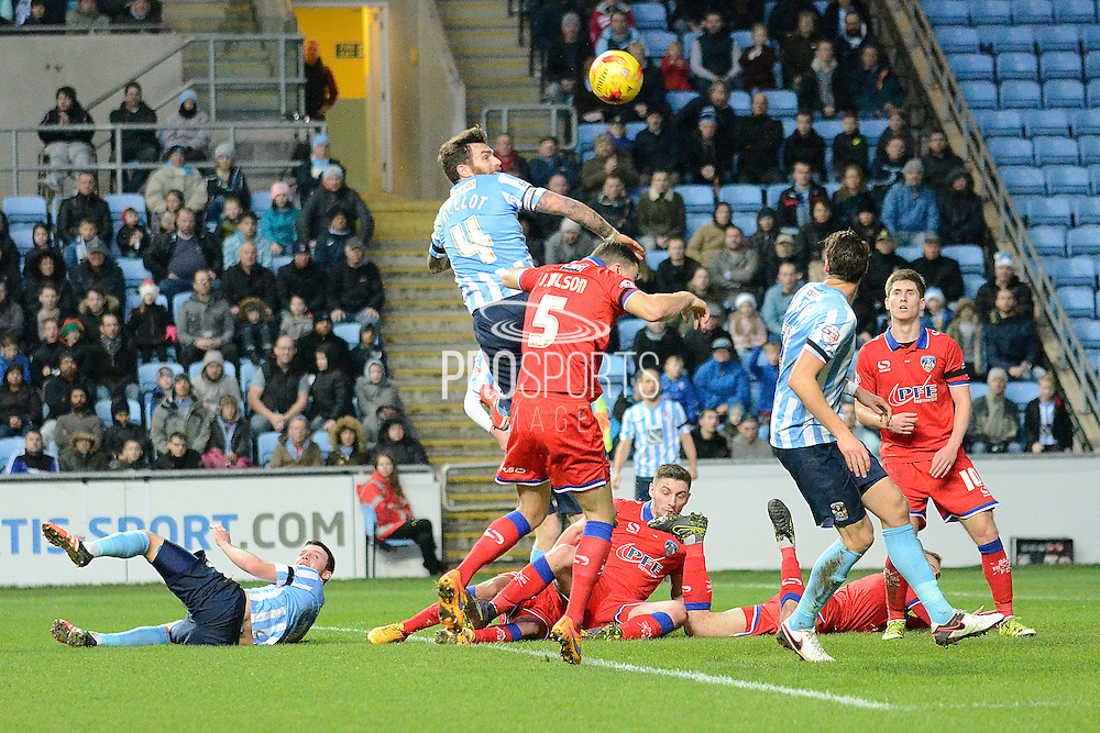 Coventry City defender Romain Vincelot wins a header during the Sky Bet League 1 match between Coventry City and Oldham Athletic at the Ricoh Arena, Coventry, England on 19 December 2015. Photo by Alan Franklin.