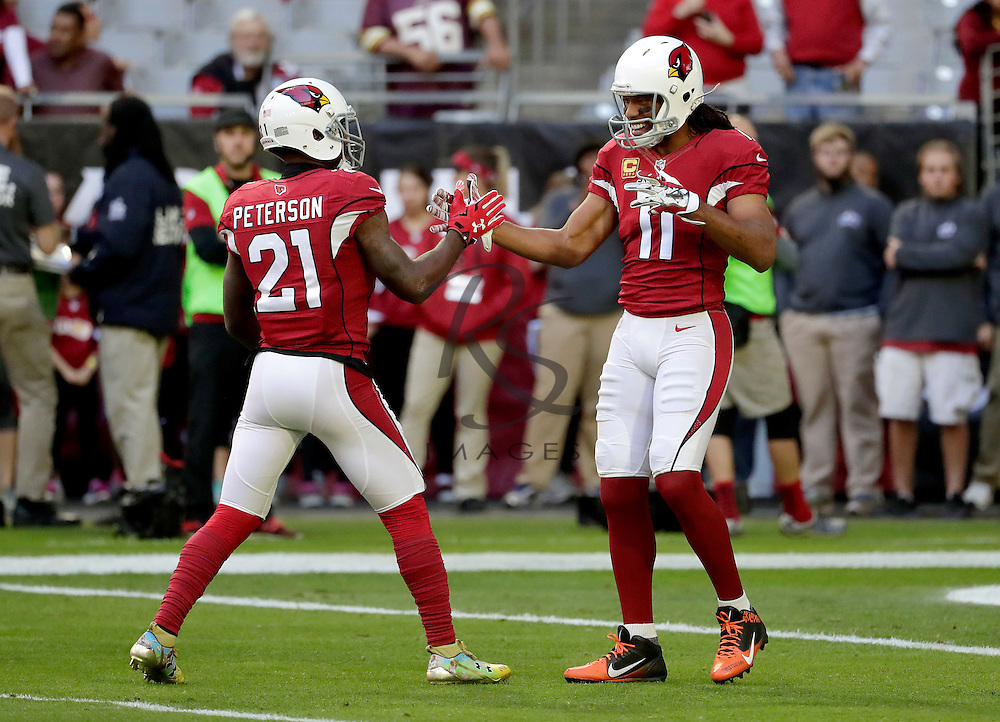 Arizona Cardinals wide receiver Larry Fitzgerald (11) and cornerback Patrick Peterson (21) warm up prior to an NFL football game against the Washington Redskins, Sunday, Dec. 4, 2016, in Glendale, Ariz. (AP Photo/Rick Scuteri)