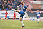 Wigan Athletic Defender, Jason Pearce with a last few minute stretches during the Sky Bet League 1 match between Wigan Athletic and Oldham Athletic at the DW Stadium, Wigan, England on 13 February 2016. Photo by Mark Pollitt.