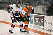 RIT's Lindsay Stenason competes with a defender during an exhibition game at RIT's Gene Polisseni Center on Monday, September 29, 2014.