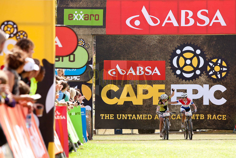 Todays ladies winners, Sara Mertens(L) and Laura Turpijn(R) at the finish of stage 6 of the 2013 Absa Cape Epic Mountain Bike stage race from Wellington to Stellenbosch, South Africa on the 23 March 2013..Photo by Sam Clark/Cape Epic/SPORTZPICS