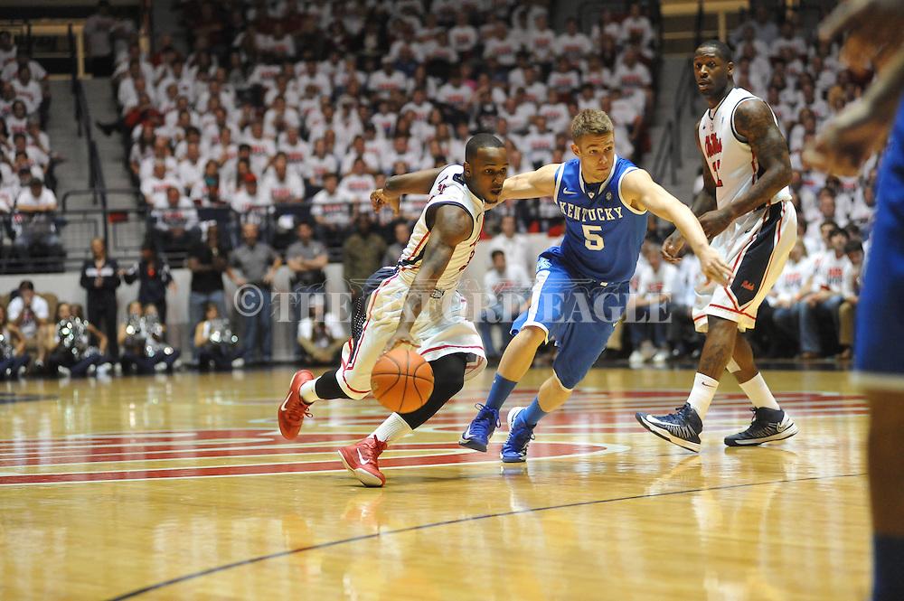 "Ole Miss' Derrick Millinghaus (3) vs. Kentucky's Jarrod Polson (5) at the C.M. ""Tad"" Smith Coliseum on Tuesday, January 29, 2013.  (AP Photo/Oxford Eagle, Bruce Newman).."