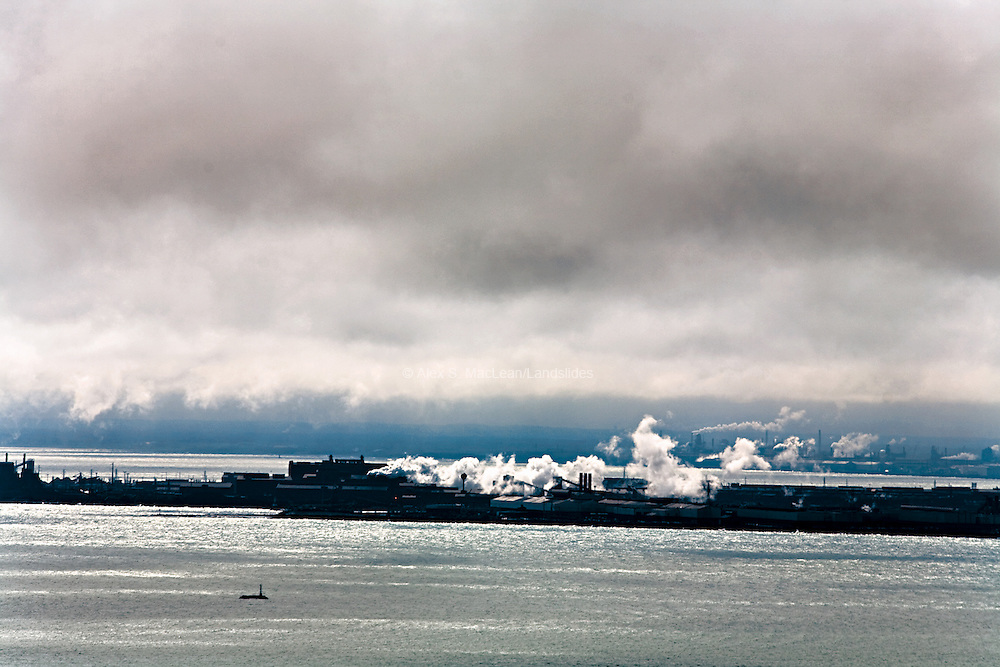 Indiana Harbor, the largest steel producer in the country, employs blast furnaces to convert iron ore into steel.  This process emits pollutants, blurring the line between the earth and sky.
