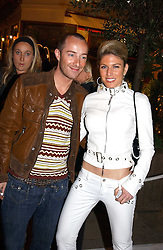 Fashion designer SCOTT HENSHALL and HOFIT GOLAN at a party to celebrate the opening of the Absolut Icebar London, 134 Heddon Street, London on 29th September 2005.<br /><br />NON EXCLUSIVE - WORLD RIGHTS