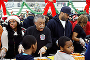 New York, NY- December 25-  l to r: Dominique Sharpton, Rev. Al Sharpton nand Londell McMillian at the Rev. Al Sharpton and National Action Network Feeding of the Hungry on Christmas Day & Toy Giveaway at the Annual NAN Event held at the NAN's House of Justice on December 25, 2011 in Harlem, New York City. Photo Credit: Terrence Jennings