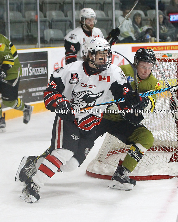 TRENTON, ON  - MAY 4,  2017: Canadian Junior Hockey League, Central Canadian Jr. &quot;A&quot; Championship. The Dudley Hewitt Cup. Game 5 between Powassan Voodoos and the Georgetown Raiders. Michael Vukojevic #44 of the Georgetown Raiders and  Kyle Challis #14 of the Powassan Voodoos follows the play during the second period.<br /> (Photo by Tim Bates / OJHL Images)