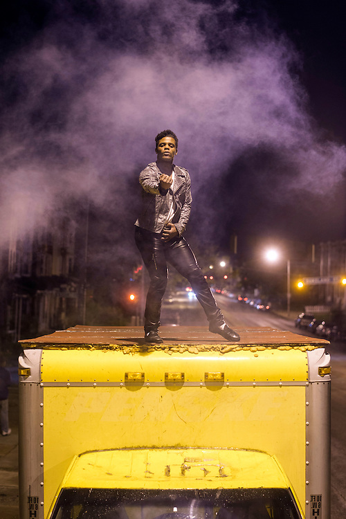 Baltimore, Maryland - April 30, 2015: For the past week Dimitri Reeves, a Baltimore-based Michael Jackson tribute performer, and recording artist, has been dancing, famously atop a yellow truck, for protestors and police in the riot-stricken areas of West Baltimore.<br /> <br /> CREDIT: Matt Roth