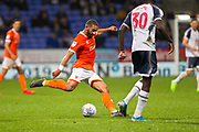 Blackpool midfielder Liam Feeney has a shot at goal during the EFL Sky Bet League 1 match between Bolton Wanderers and Blackpool at the University of  Bolton Stadium, Bolton, England on 7 October 2019.