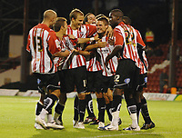 Ryan Dickson (Brentford) celebrates his goal with team mates. Brentford v Norwich City 18/08/2009 1568 Credit : Colorsport / Andrew Cowie