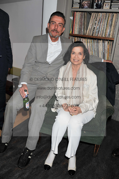 BIANCA JAGGER and MARCEL ODENBACH at a dinner hosted by Bella Freud for German artist Marcel Odenbach at her home 275 Kensal Road, London W10 on 6th June 2011.