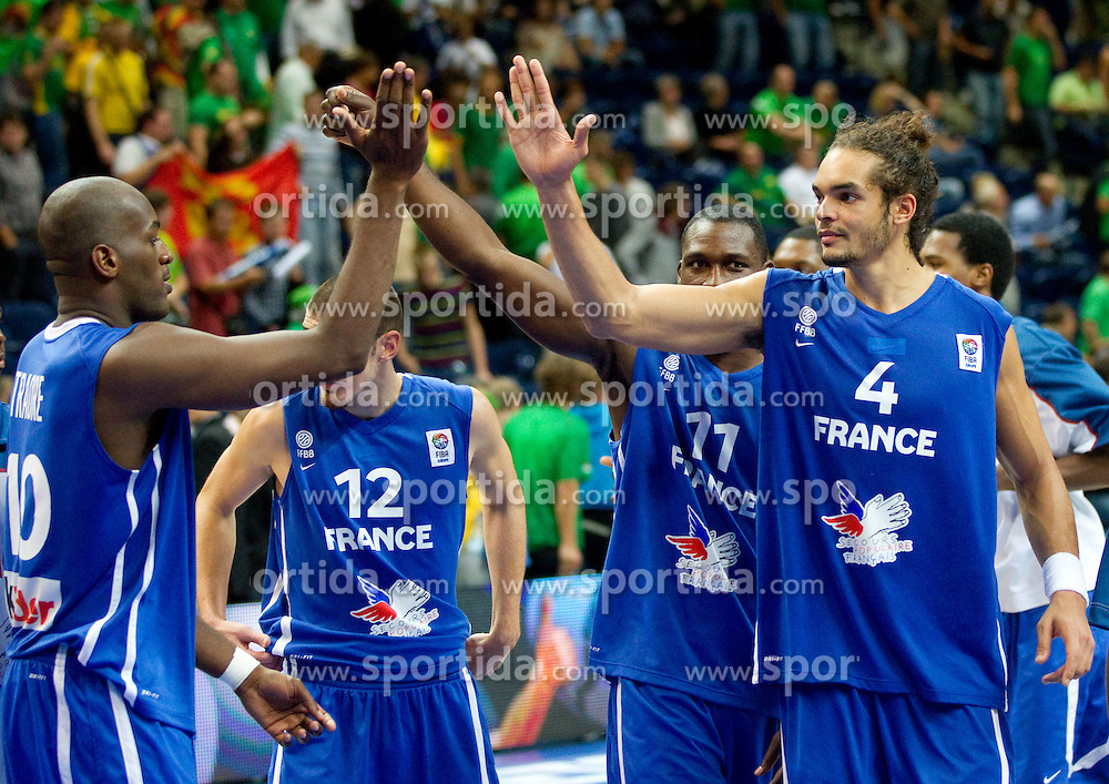 Ali Traore, Florent Pietrus and Joakim Noah celebrate after the basketball game between National basketball teams of Turkey and France at FIBA Europe Eurobasket Lithuania 2011, on September 7, 2011, in Siemens Arena,  Vilnius, Lithuania.France defeated Turkey 68-64. (Photo by Vid Ponikvar / Sportida)