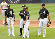 CHICAGO - JUNE 22:  (Left to right) Tim Anderson #7, Yoan Moncada #10, Yolmer Sanchez #5 and Jose Abreu #79 of the Chicago White Sox look on during a pitching change against the Oakland Athletics during game one of a double header on June 0220, 2018 at Guaranteed Rate Field in Chicago, Illinois.  (Photo by Ron Vesely)  Subject: Tim Anderson, Yoan Moncada, Yolmer Sanchez, Jose Abreu