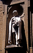 Architectural sculpture of Giovanni Villani, Italian diplomat and chronicler, near the Piazza della Signoria, Florence, Italy. Made from marble.