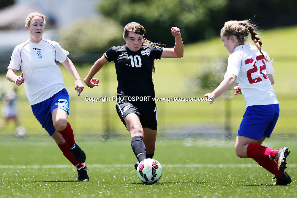 Jade Parris of NZF Development looks to get past Leah Mettam of Auckland Football. 2014 ASB Women's League football match, Auckland Football v NZF Development at William Green Domain, Auckland, New Zealand. Sunday 23 November 2014. Photo: Anthony Au-Yeung / photosport.co.nz