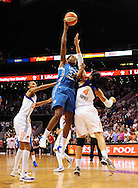 Sep 11, 2011; Phoenix, AZ, USA; Minnesota Lynx forward Rebekkah Brunson (32) puts up a shot against the Phoenix Mercury forward Candice Dupree (4) during the first half at the US Airways Center.  The Lynx defeated the Mercury 96-90. Mandatory Credit: Jennifer Stewart-US PRESSWIRE