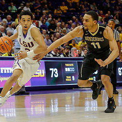 Feb 20, 2018; Baton Rouge, LA, USA; LSU Tigers guard Tremont Waters (3) drives past Vanderbilt Commodores forward Jeff Roberson (11) during the second half at the Pete Maravich Assembly Center. LSU defeated Vanderbilt 88-78. Mandatory Credit: Derick E. Hingle-USA TODAY Sports