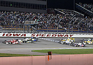 The green flag drops during a restart in the IZOD IndyCar Iowa Corn Indy 250 auto race at the Iowa Speedway in Newton, Iowa on Saturday, June 23, 2012.