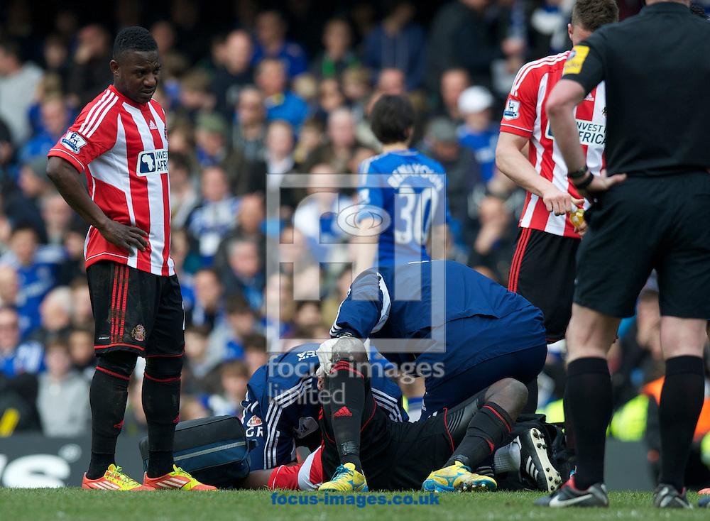 Picture by Alan Stanford/Focus Images Ltd +44 7915 056117.07/04/2013.Alfred N'Diaye of Sunderland gets attention for an injury during the Barclays Premier League match at Stamford Bridge, London.