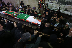 January 30, 2018 - Gaza, gaza strip, Palestine - Palestinian mourners carry the body of Hamas senior leader Imad al-Alami during his funeral at the al-Omari mosque in Gaza City on January 30, 2018. A senior Hamas official has died in Gaza three weeks after shooting himself in the head in what officials described as an accident, the Palestinian Islamist group announced. Alami was wounded on January 9 while ''inspecting his personal weapon in his home'' in Gaza, Hamas said at the time. (Credit Image: © Majdi Fathi/NurPhoto via ZUMA Press)
