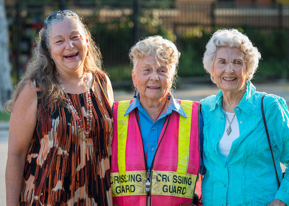 Crossing guard Joy Wilson stops traffic on her 84th birthday for students at Helms Elementary School, September 8, 2014.