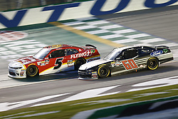 July 13, 2018 - Sparta, Kentucky, United States of America - Michael Annett (5) and Ty Majeski (60) battle for position during the Alsco 300 at Kentucky Speedway in Sparta, Kentucky. (Credit Image: © Chris Owens Asp Inc/ASP via ZUMA Wire)