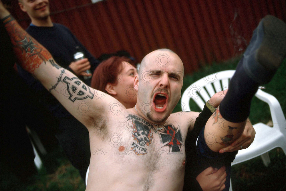 Members of  Blood & honnour displays his tattoos Nazis..