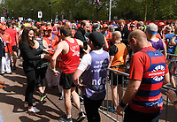 Catherine, Duchess of Cambridge, Prince William, Duke of Cambridge and Prince Harry give out medals to the finishers of the 2017 Virgin Money London Marathon.<br /> The Virgin Money London Marathon, 23rd April 2017.<br /> <br /> Photo: Karwai Tang for Virgin Money London Marathon<br /> <br /> For further information: media@londonmarathonevents.co.uk