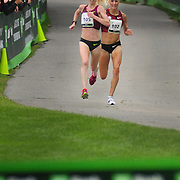 SOUTH PORTLAND, Maine -- 8/2/14<br /> Gemma Steel, left, and Shalene Flanagan sprint to the finish to be the first and second place female finishers at Saturday's Beach to Beacon road race. Steel, of the United Kingdom, finished at 31:26 with Flanagan officially a second behind her. <br /> <br /> The Beach to Beacon, a 10k road race through the streets of Cape Elizabeth and South Portland Maine, brought world class athletes together with more than 2000 runners from all over the world. Weather was humid and grey, but the rain mostly held off through the day.  Photo  ©2014 by Roger S. Duncan