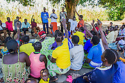Group counselling. Consellors trained by the charity lead the session which involves plenty of enthusiastic interation by the class. Visit to the work of Network for Africa in Patongo, Northern Uganda, November 2012.