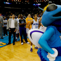 Apr 14, 2013; New Orleans, LA, USA; New Orleans Hornets mascot Hugo watches the video board displaying highlights of the Hornets history support following a loss to the Dallas Mavericks at the New Orleans Arena. The Mavericks defeated the Hornets 107-89. The game was the final home game for the Hornets franchise as they will be rebranded as the New Orleans Pelicans starting next season. Mandatory Credit: Derick E. Hingle-USA TODAY Sports