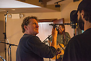 Eddie Ashworth adjusts the position of a microphone for musician Wilie Perkins.