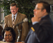 Dr. Don Hare, left, listens to comments by principal Geovanny Ponce during a media conference announcing a partnership between Jones Futures Academy and the Prairie View A&M Nursing School, April 15, 2015.