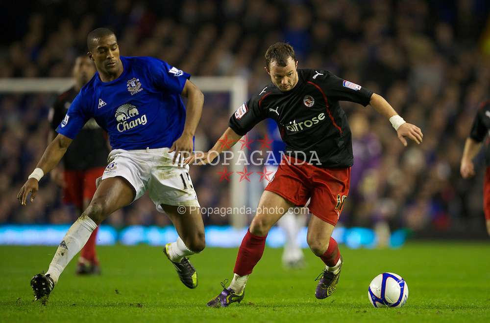 LIVERPOOL, ENGLAND - Tuesday, March 1, 2011: Everton's Sylvain Distin and Reading's Noel Hunt during the FA Cup 5th Round match at Goodison Park. (Photo by David Rawcliffe/Propaganda)