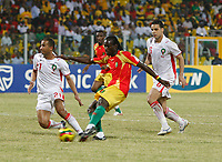 Photo: Steve Bond/Richard Lane Photography.<br /> Guinea v Morocco. Africa Cup of Nations. 24/01/2008. Ismael Bangoura (C) drives in Guinea's second goal