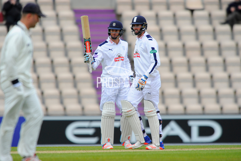 50 runs for McLaren - Hampshire batsman Ryan McLaren pictured with Reece Topley raises his bat to the crowd after scoring a vital 50 for Hampshire during the Specsavers County Champ Div 1 match between Hampshire County Cricket Club and Warwickshire County Cricket Club at the Ageas Bowl, Southampton, United Kingdom on 10 April 2016. Photo by Graham Hunt.