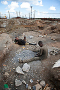 Kipushi, DRC. March 2009. In this almost alien landscape, the extent of people's suffering seems unfathomable to outsiders, but the human spirit is resilient and a sense of humour certainly a pre-requisite to get through the day.