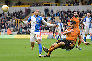 Wolverhampton Wanderers defender Danny Batth clears the ball from Blackburn Rovers striker Simeon Jackson during the Sky Bet Championship match between Wolverhampton Wanderers and Blackburn Rovers at Molineux, Wolverhampton, England on 9 April 2016. Photo by Alan Franklin.