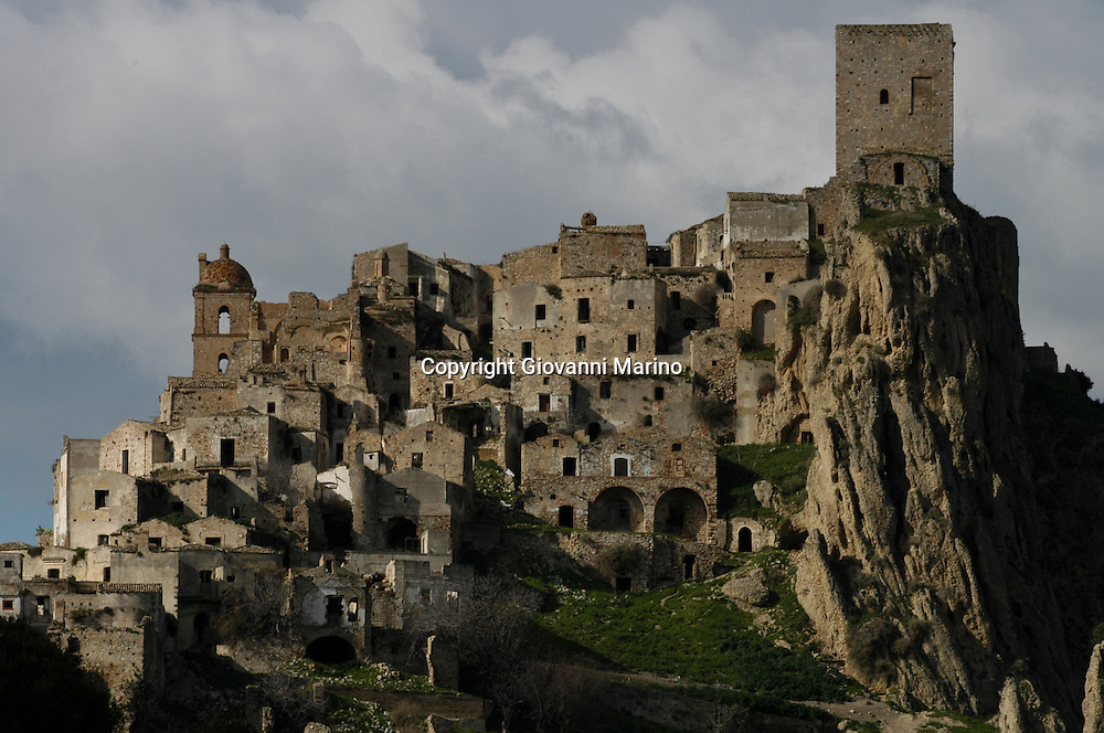 Craco/Basilicata/Italy - oct 10, 2009<br /> Craco is an abandoned Italian village located in the Region of Basilicata and the Province of Matera. During the mid-twentieth century, recurring earthquakes began to take a toll on the viability of the town. Between 1959 and 1972, portions of the village were severely damaged and rendered uninhabitable by a series of frana, or landslides. The geological threat to the town was known to scientists since 1910, due to Craco's location on a hill of Pliocene sands overhanging the clays, with ravines causing progressive incisions. Now, Craco is uninhabited. In 1963, the 1,800 inhabitants were transferred to a valley in a locality called Craco Peschiera. That population is now down to about 970 inhabitants.