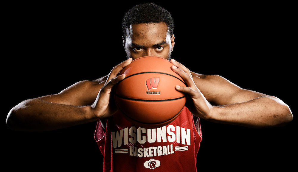 UW-Madison Badgers' Basketball player Marcus Landry. With a wife and three children, along with impressive basketball skills, Marcus Landry is viewed as a role model by his teammates. Kris Ugarriza