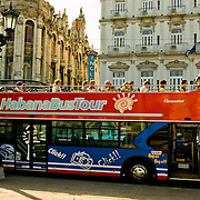 Sightseeing bus in front of the famed Hotel Inglaterra in Central Havana, Havana Centro, Habana Centro, Centro Habana, Cuba.