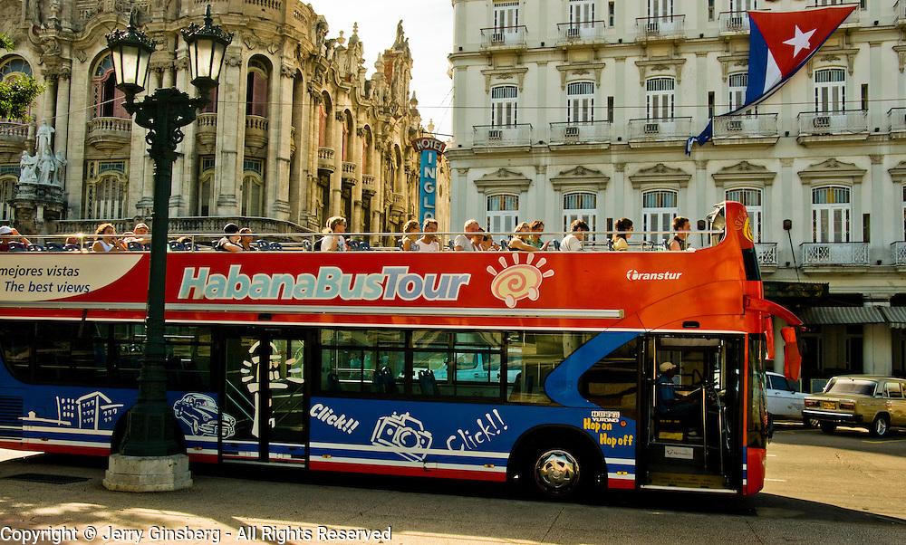 Sightseeing bus in front of the famed Hotel Inglaterra in Central Havana, Havana Centro, Habana Centro, Centro Habana, Cuba.