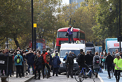 © Licensed to London News Pictures. 15/10/2019. London, UK. XR activist block Millbank just before Lambeth Bridge in Westminster. Activists continue to occupy roads around Westminster and the City for the 9th day. Photo credit: Alex Lentati/LNP