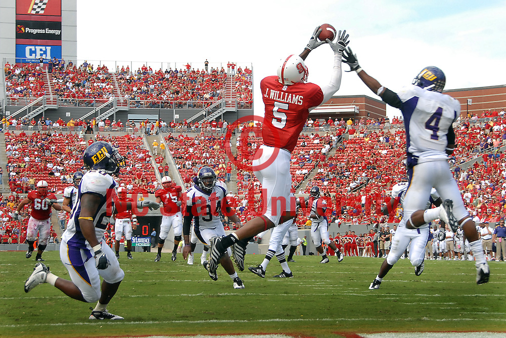 Jarvis WIlliams (5) hauls in a touchdown pass against ECU. PHOTO BY ROGER WINSTEAD