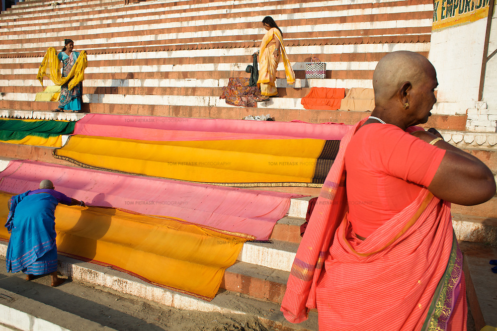 Hindu pilgrims gather at the banks of the Ganges river at the holy city of Varanasi, also known as Benares...Photo: Tom Pietrasik.Varanasi, Uttar Pradesh, India.February 3rd 2010