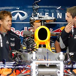 FORMULA 1 SANTANDER BRITISH GRAND PRIX ..Sebastian Vettel chats with his engineers in the Red Bull garage.....(c) STEPHEN LAWSON | SportPix.org.uk